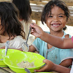 Child eating FMSC meal
